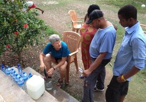 Dr Wendy Pollock filters water for local residents in Petit Goave, October 2016