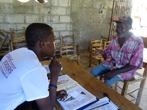 James Alcy, Pharmacist and Homéopathes Communautaires working with a patient during clinic, November 2016, Haiti.